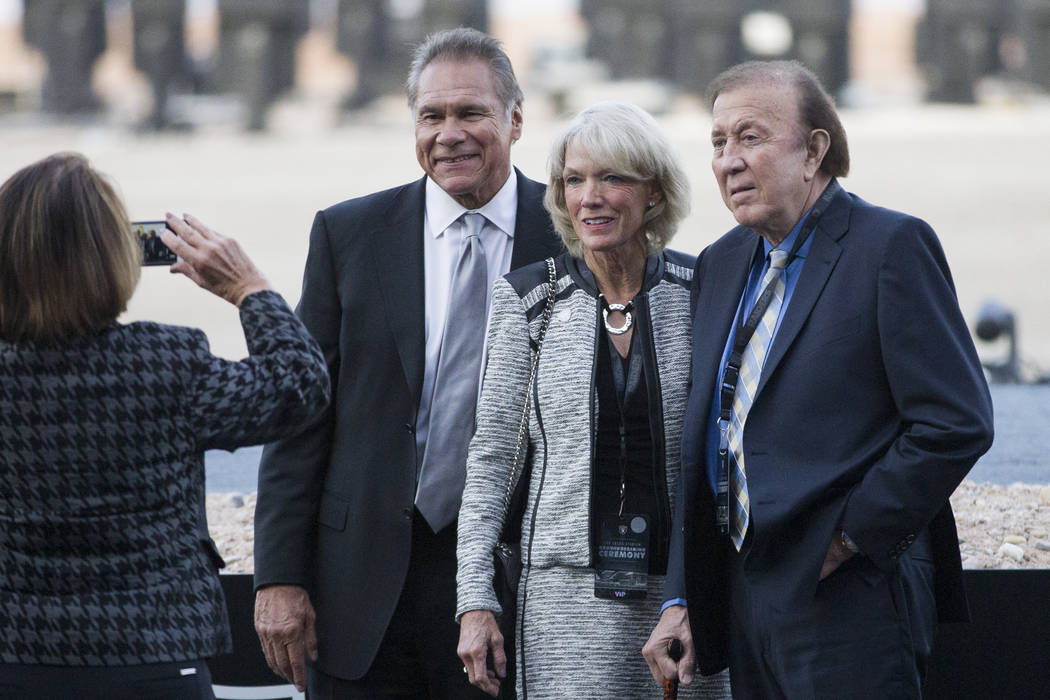 Former Raiders players Jim Plunkett, from left, with his wife Gerry, and Fred Biletnikoff, duri ...