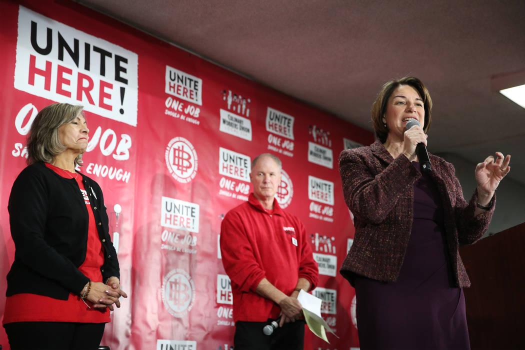 Democratic presidential candidate Amy Klobuchar, center, with Geoconda Arguello-Kline, left, se ...