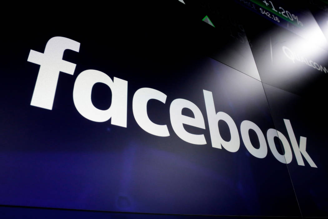 FILE - In this March 29, 2018 file photo shows the logo for Facebook at the Nasdaq MarketSite, ...