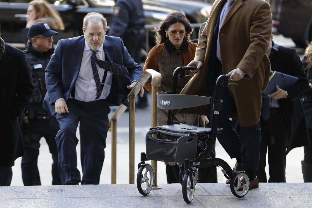 Harvey Weinstein arrives at a Manhattan courthouse for his rape trial in New York, Friday, Feb. ...