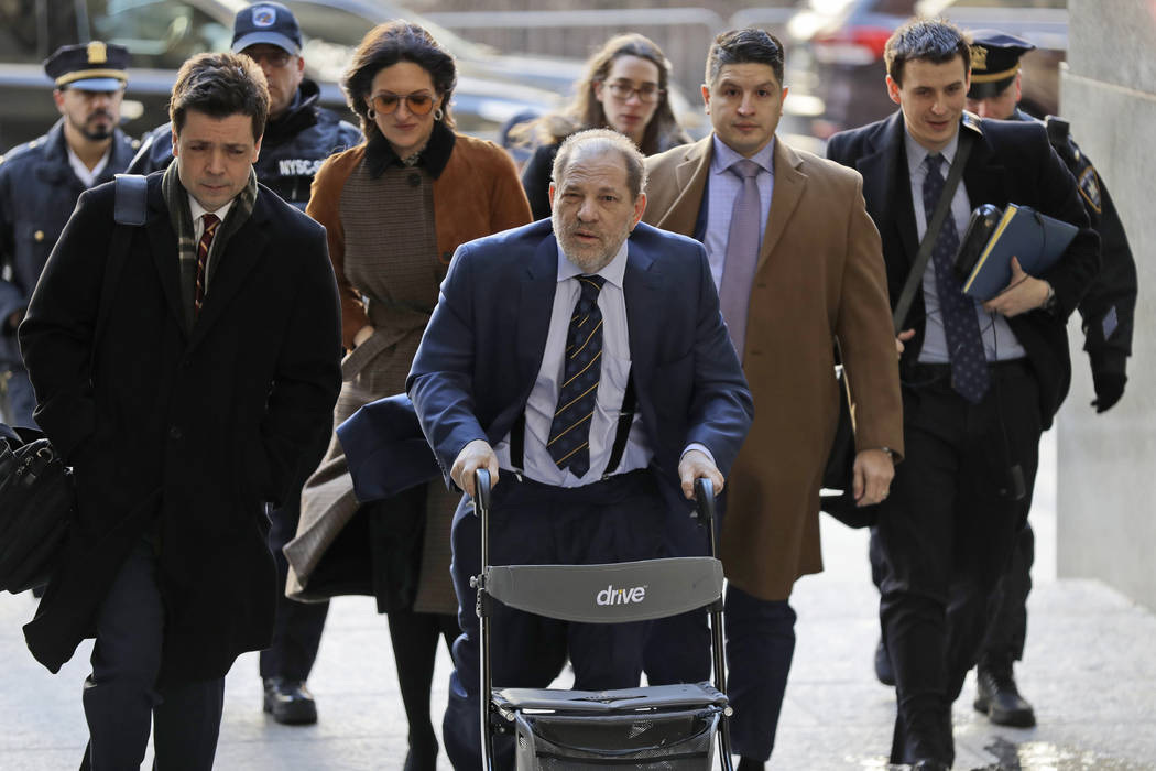 Harvey Weinstein, center, arrives at a Manhattan courthouse for his rape trial in New York, Fri ...