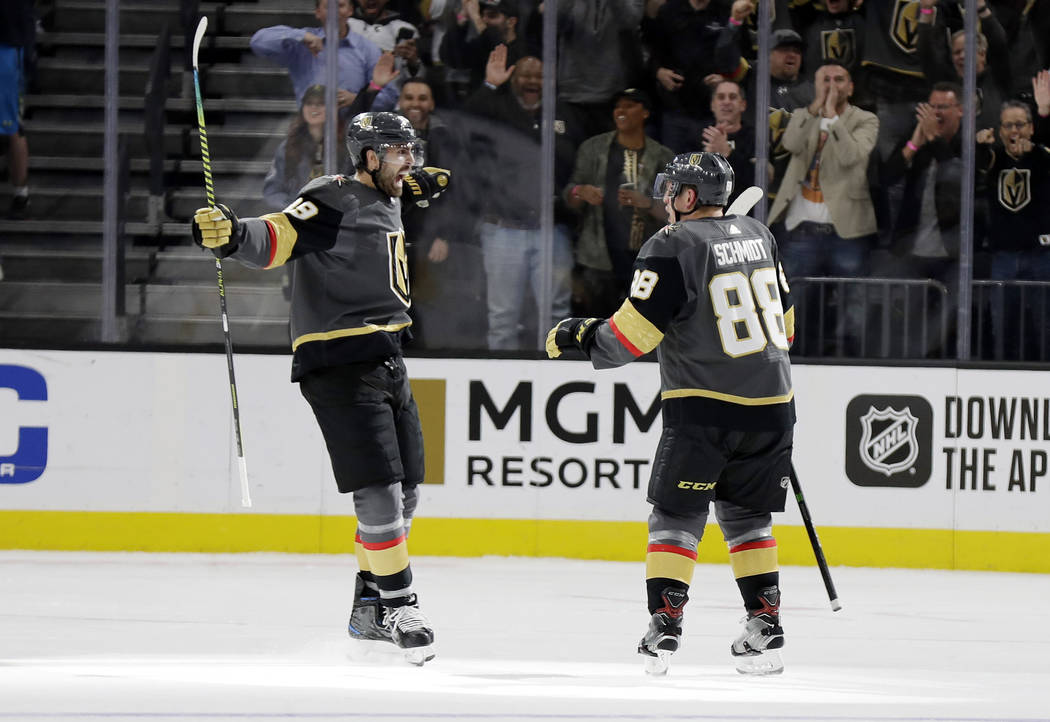 Vegas Golden Knights right wing Alex Tuch (89) and defenseman Nate Schmidt celebrate a Golden K ...