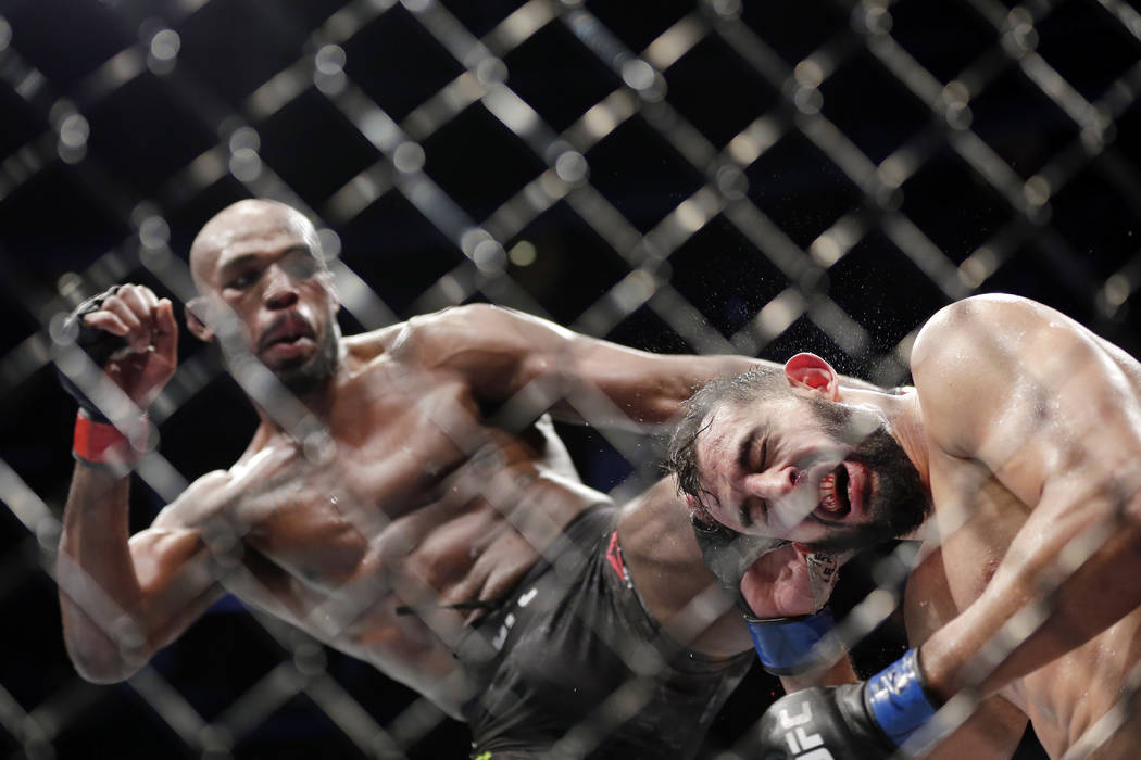 Jon Jones, left, and Dominick Reyes, right, during a light heavyweight mixed martial arts bout ...