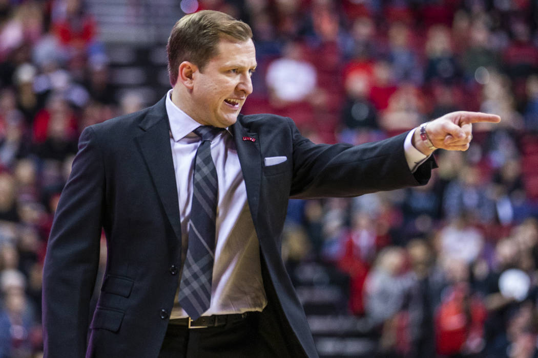 UNLV Rebels head coach T.J.Otzelberger directs his players on the court versus the New Mexico L ...