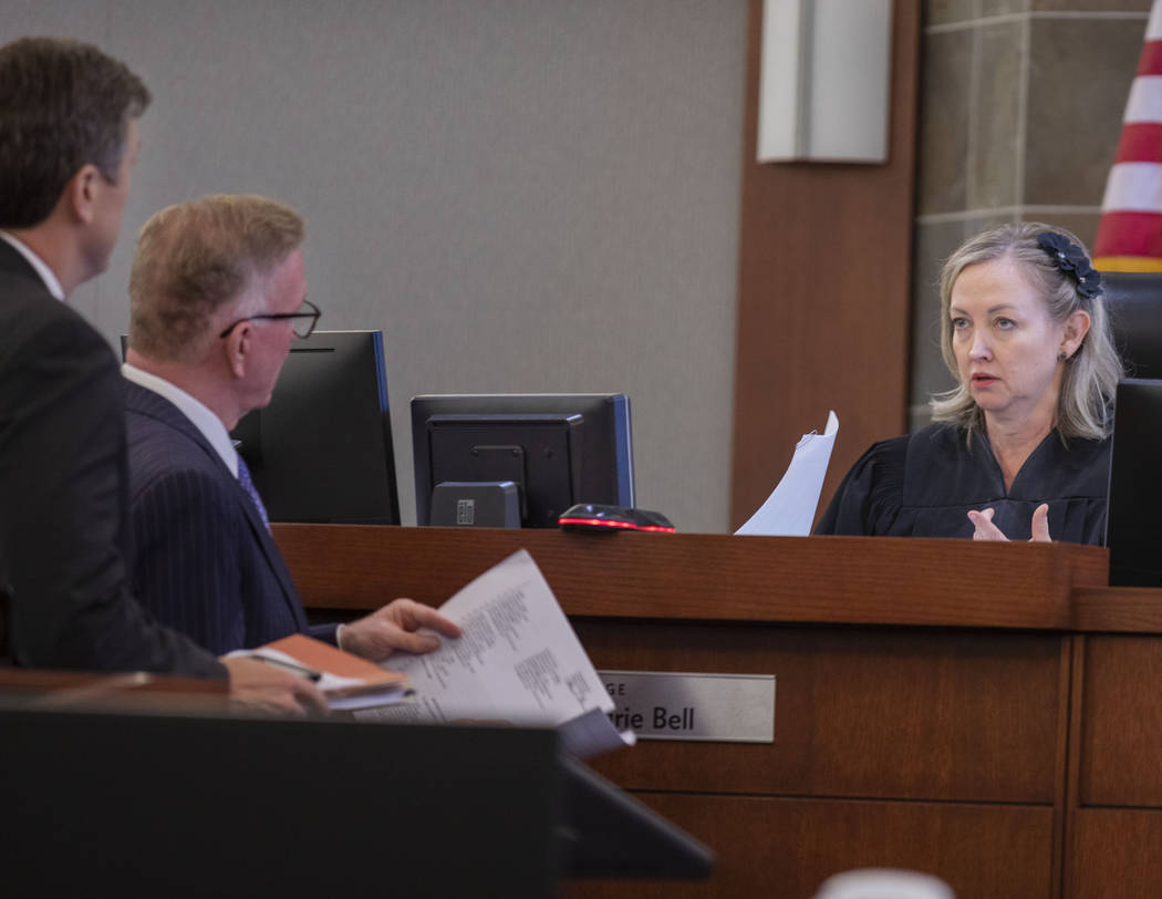 Judge Linda Marie Bell calls up attorneys during a court hearing to determine how funds from th ...