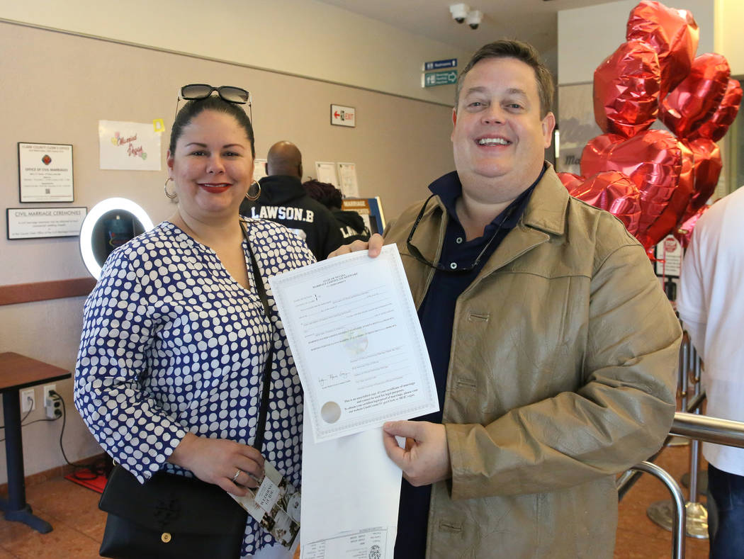 Roberto Garden and Martha Lugo of Puerto Rico show off their marriage license at the Marriage L ...