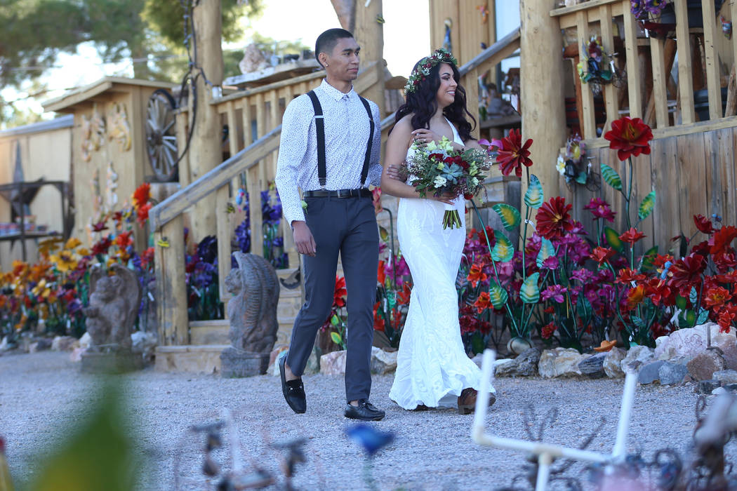 Mely Ayala, right, of San Diego gets walked to get married by her brother Luis Elias during the ...