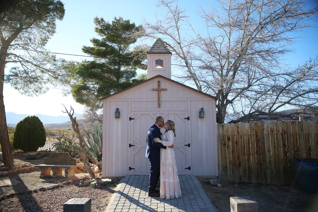 Richard Raney and Laura Eshelman of Overland Park, Kan., share a kiss in their wedding during t ...