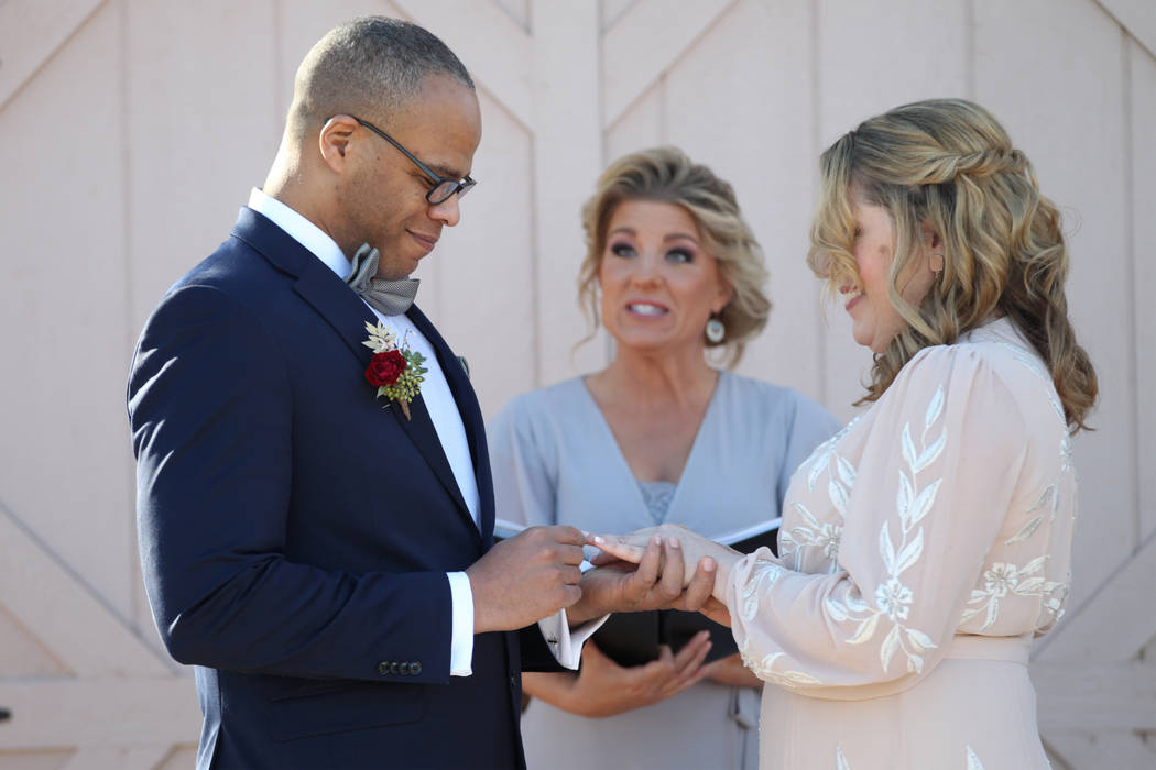 Richard Raney and Laura Eshelman of Overland Park, Kan., get married by wedding officiant Angie ...