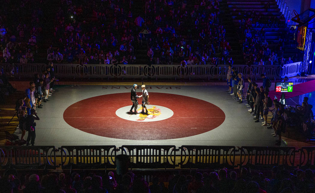 Competitors meet in the center of the mat after being introduced during the 4A state wrestling ...