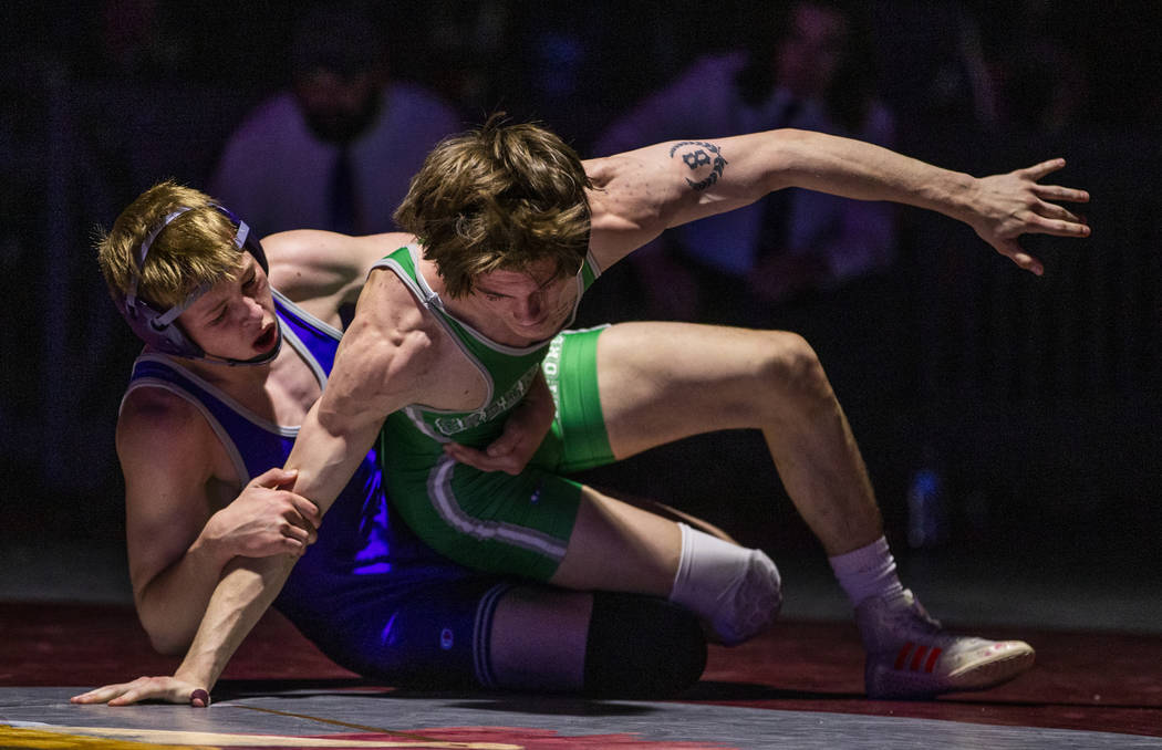 Spanish Spring's Keegan Hassell-Cramer , left, attempts to keep Green Valley's William Zernich ...