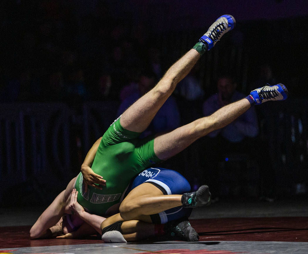 Green Valley's Derek Recktenwald, left, is tossed to the mat by Foothill's Micah Schneider in t ...