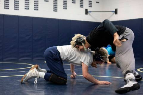 Senior Matt Van Riel, right, wrestles against senior Weston Presser, left, during the last prac ...