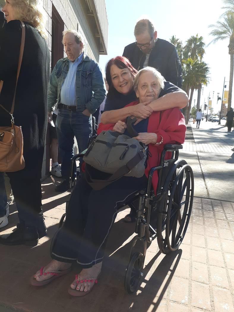 Mother Eileen Murphy is hugged by daughter Pamela Szklarski as they wait in line at Steelworker ...