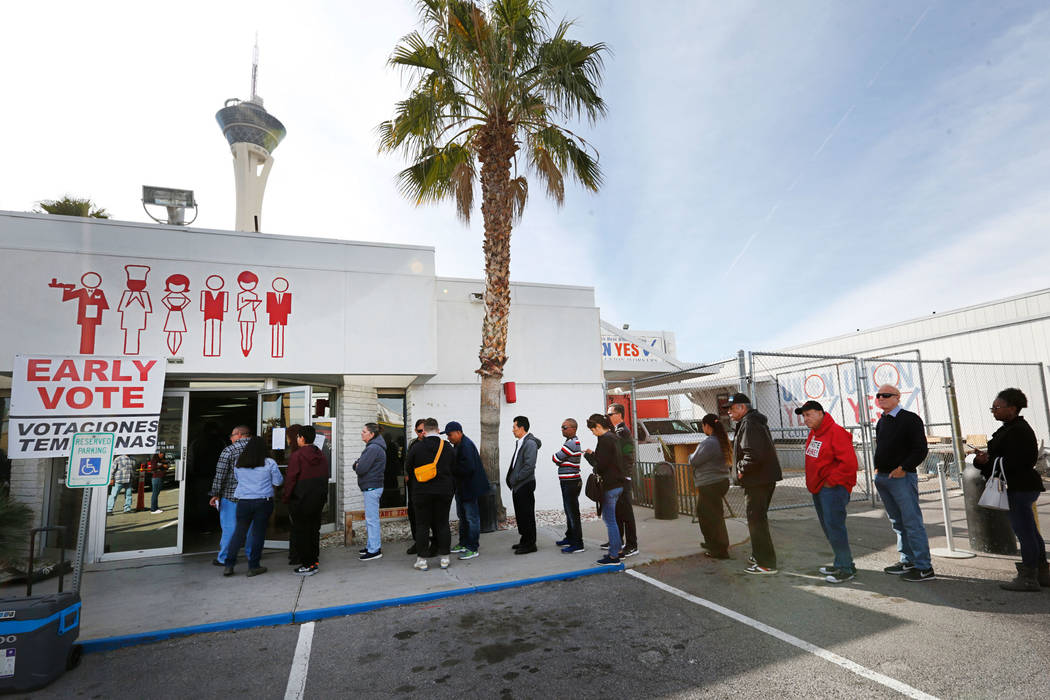 People line up to vote on the first day of early voting in the Nevada Democratic Party's ...