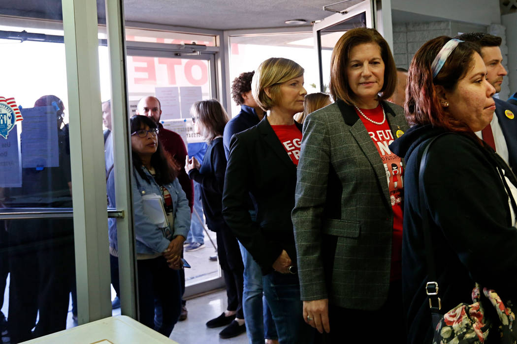 Sen. Catherine Cortez Masto, D-Nev., right, second from right, and Rep. Susie Lee, D-Nev., thir ...