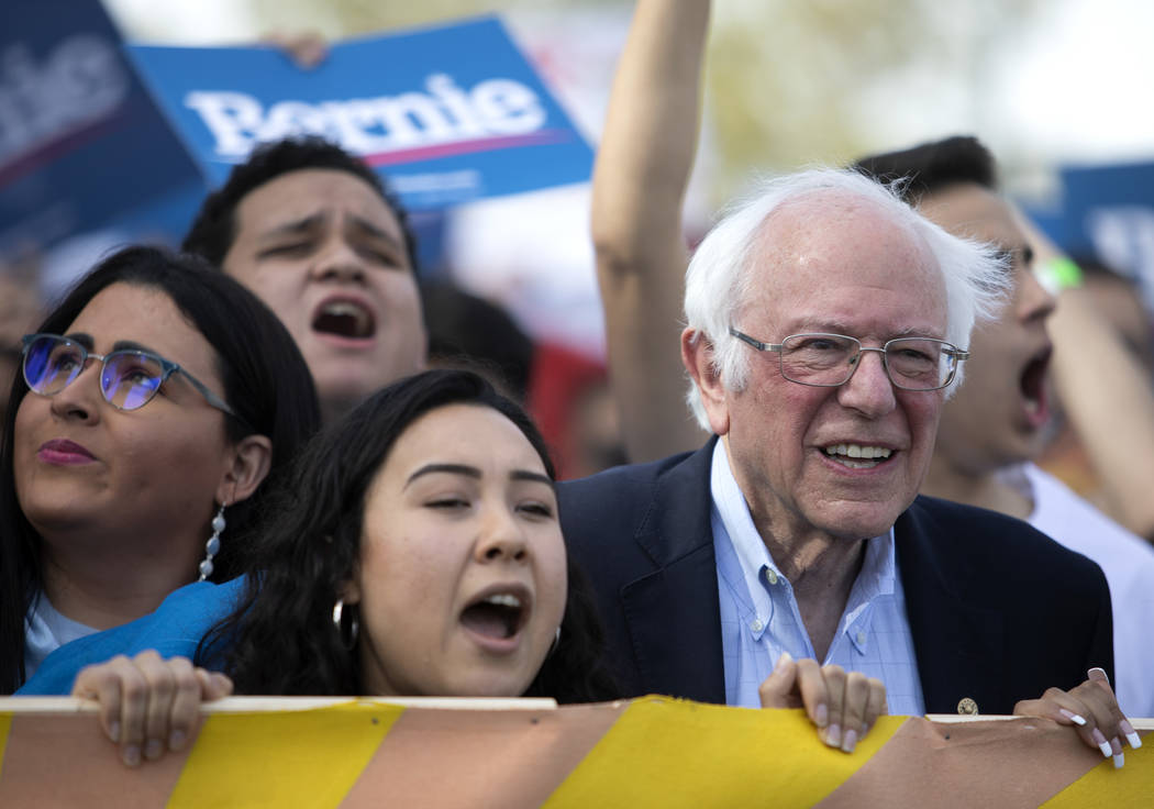 Sen. Bernie Sanders marches from Desert Pines High School to a polling location during the &quo ...