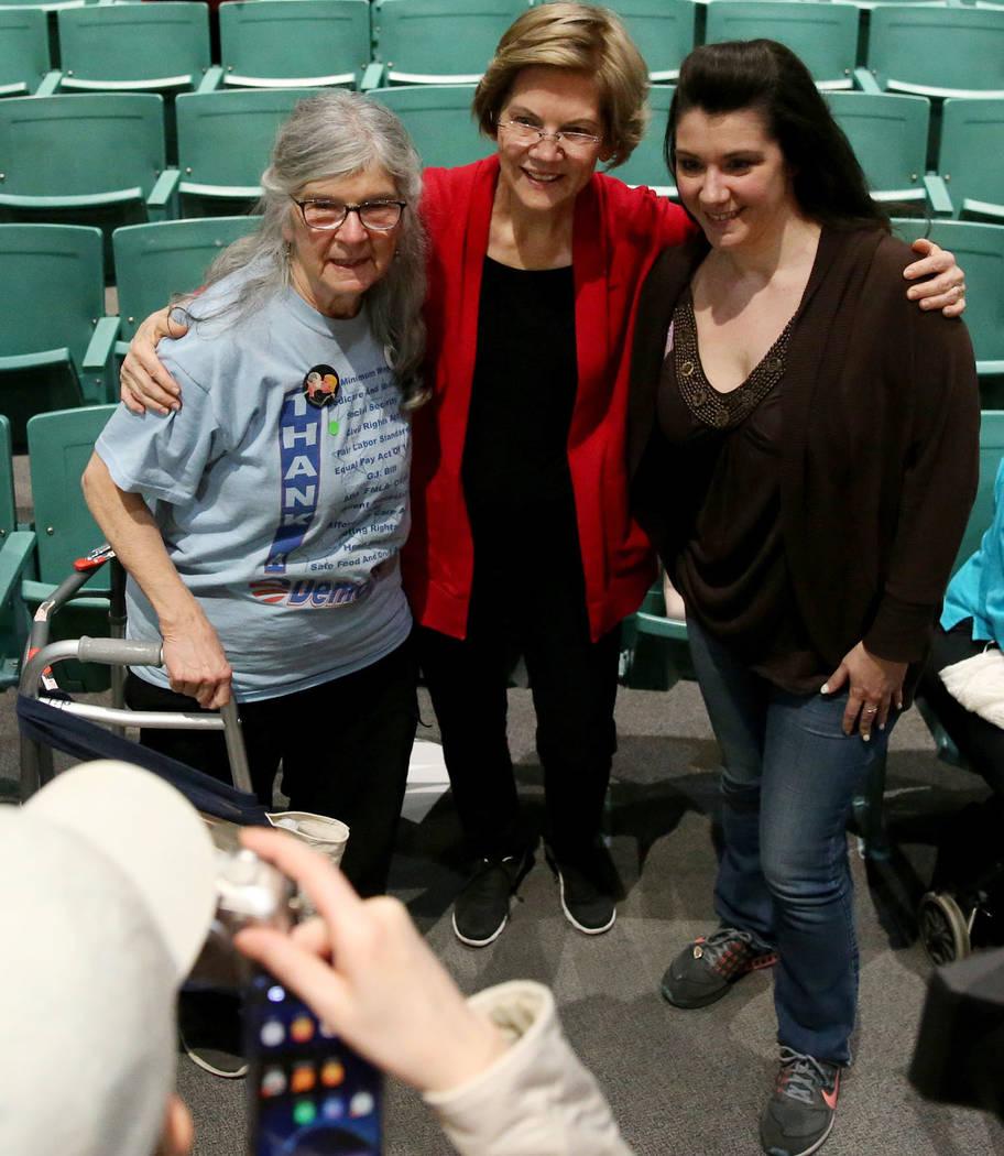 Democratic Presidential Candidate Elizabeth Warren, center, takes a photo with Marlene Pikus, l ...