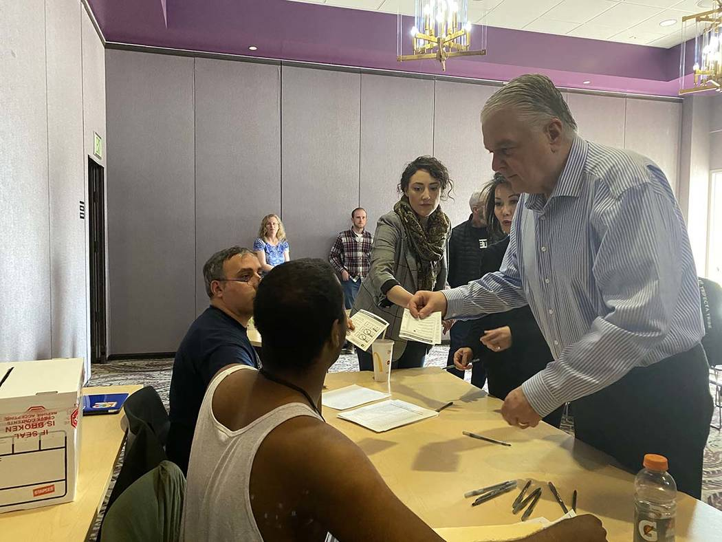 Gov. Steve Sisolak turns in his voting card on Saturday, Feb. 15, 2020. (Glenn Puit/Las Vegas R ...