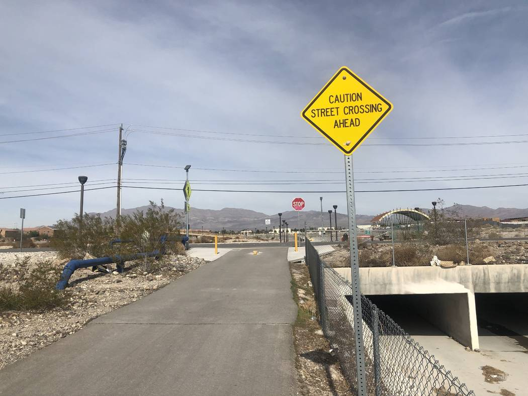 A sign warning of a street crossing ahead near where two children were hit by a truck on Friday ...
