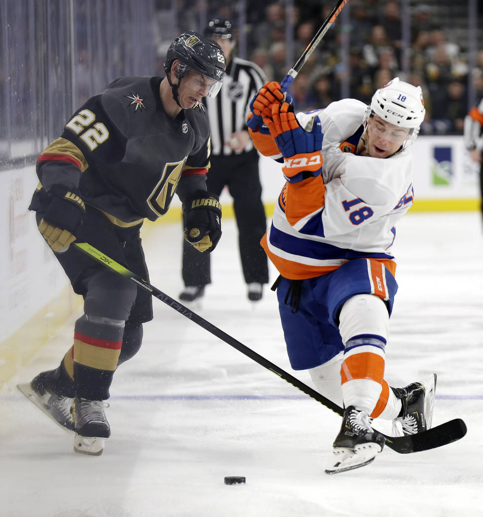 Vegas Golden Knights defenseman Nick Holden (22) and New York Islanders forward Anthony Beauvil ...