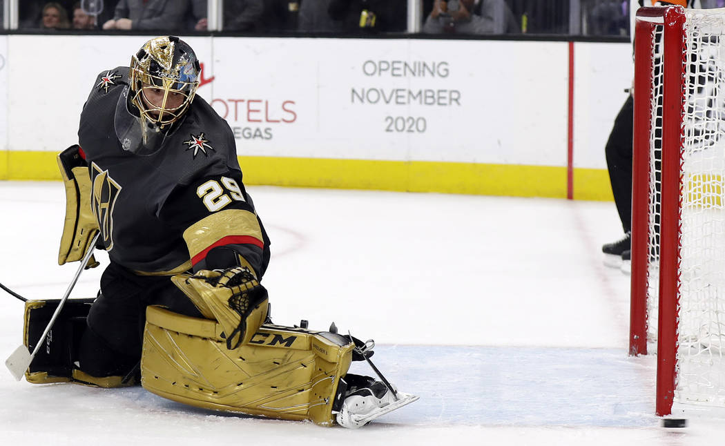 A shot flies wide past Vegas Golden Knights goalie Marc-Andre Fleury during the first period of ...