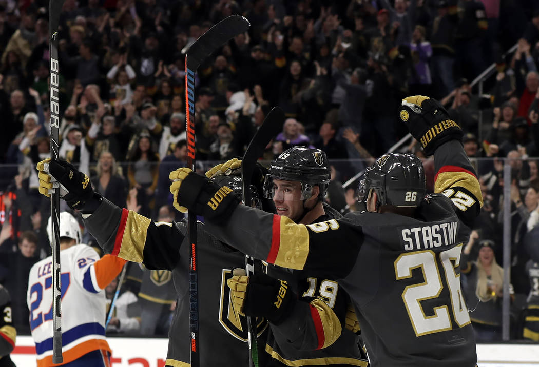 Vegas Golden Knights right wing Reilly Smith (19) celebrates after scoring against the New York ...