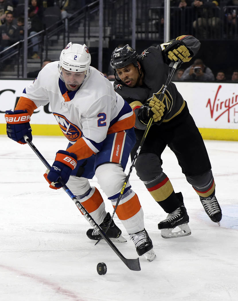 New York Islanders defenseman Nick Leddy (2) and Vegas Golden Knights right wing Ryan Reaves fi ...