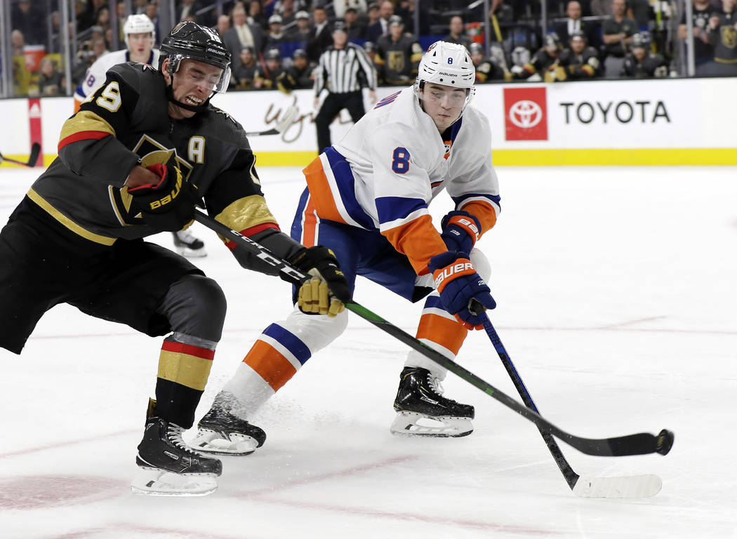 Vegas Golden Knights right wing Reilly Smith (19) shoots as New York Islanders defenseman Noah ...