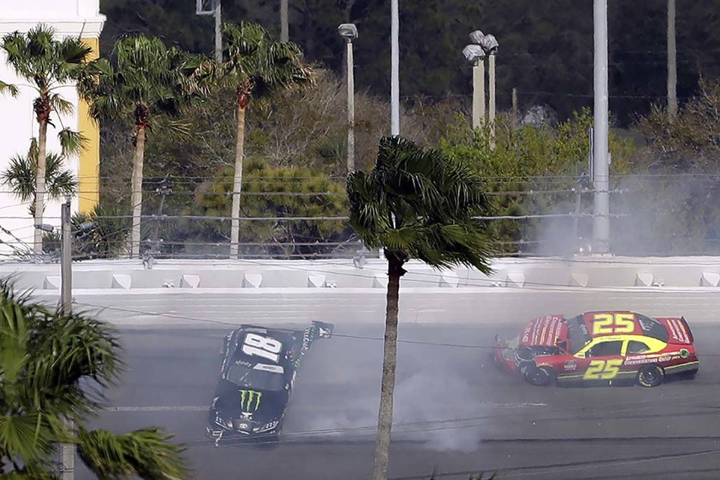 Riley Herbst (18) and Chris Cockrum (25) crash during the NASCAR Xfinity series auto race Satur ...