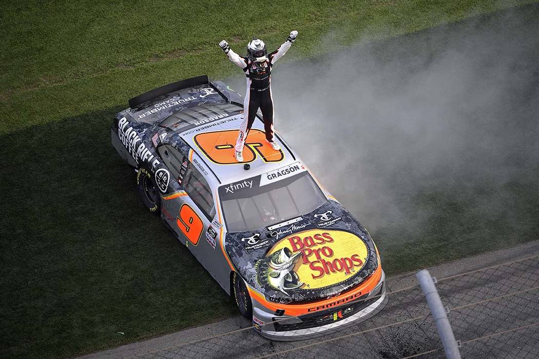 Noah Gragson (9) celebrates on the roof of his car at the finish line after winning a NASCAR Xf ...