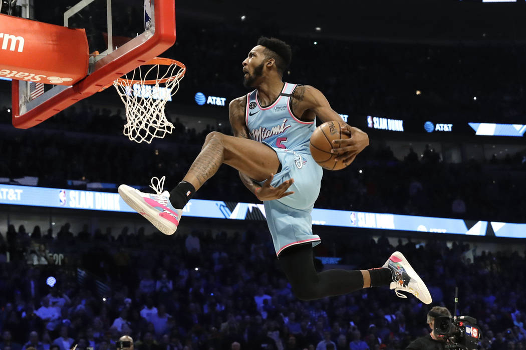 Miami Heat's Derrick Jones Jr. heads to the basket during the NBA All-Star slam dunk contest in ...