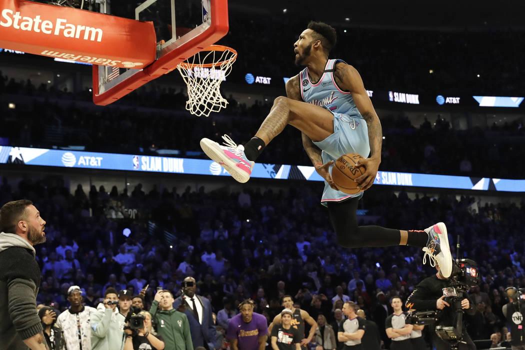 Miami Heat's Derrick Jones Jr. competes in the NBA All-Star slam dunk contest in Chicago, Satur ...