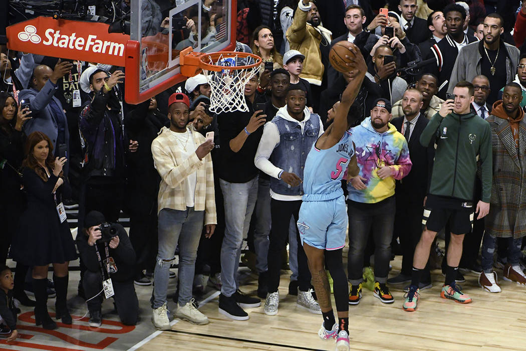 Miami Heat's Derrick Jones Jr. goes up for a dunk during the NBA All-Star slam dunk contest Sat ...