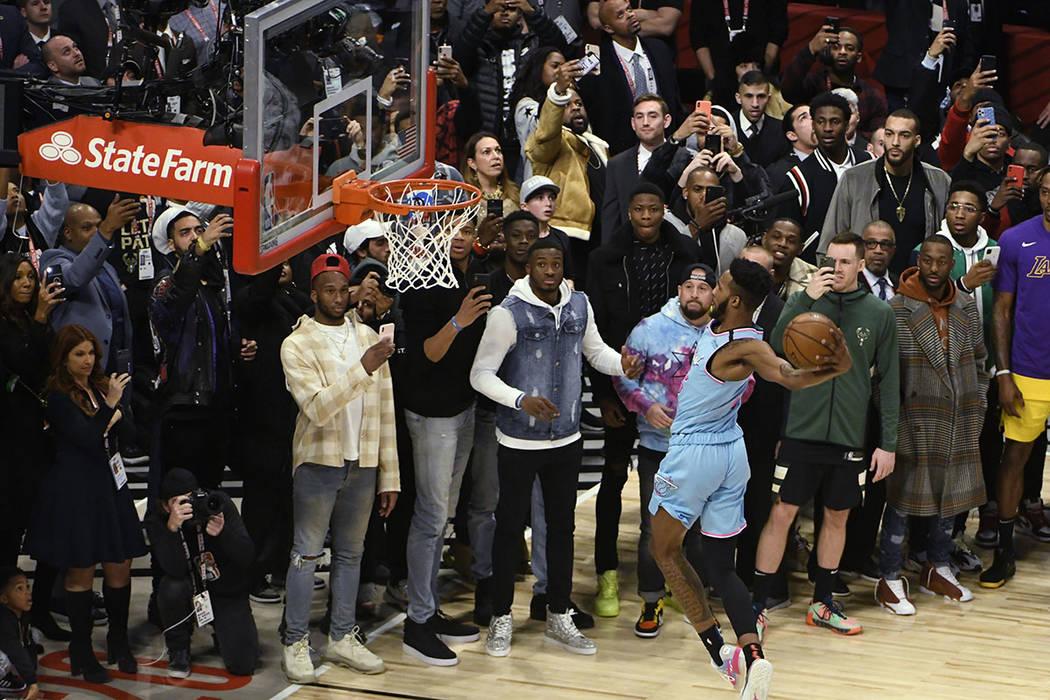 Miami Heat's Derrick Jones Jr. competes in the NBA All-Star slam dunk contest Saturday, Feb. 15 ...