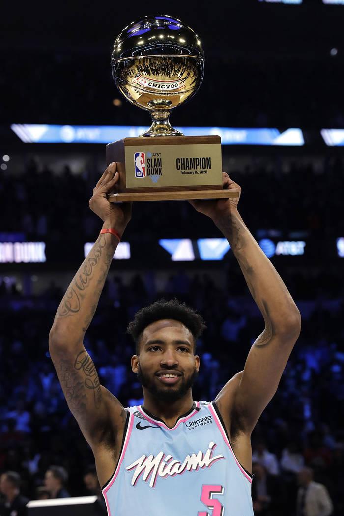 Miami Heat's Derrick Jones Jr. holds the trophy after he won the NBA All-Star slam dunk contest ...