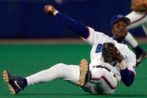 In this Sept. 17, 1999, file photo, Toronto Blue Jays third baseman Tony Fernandez throws to fi ...