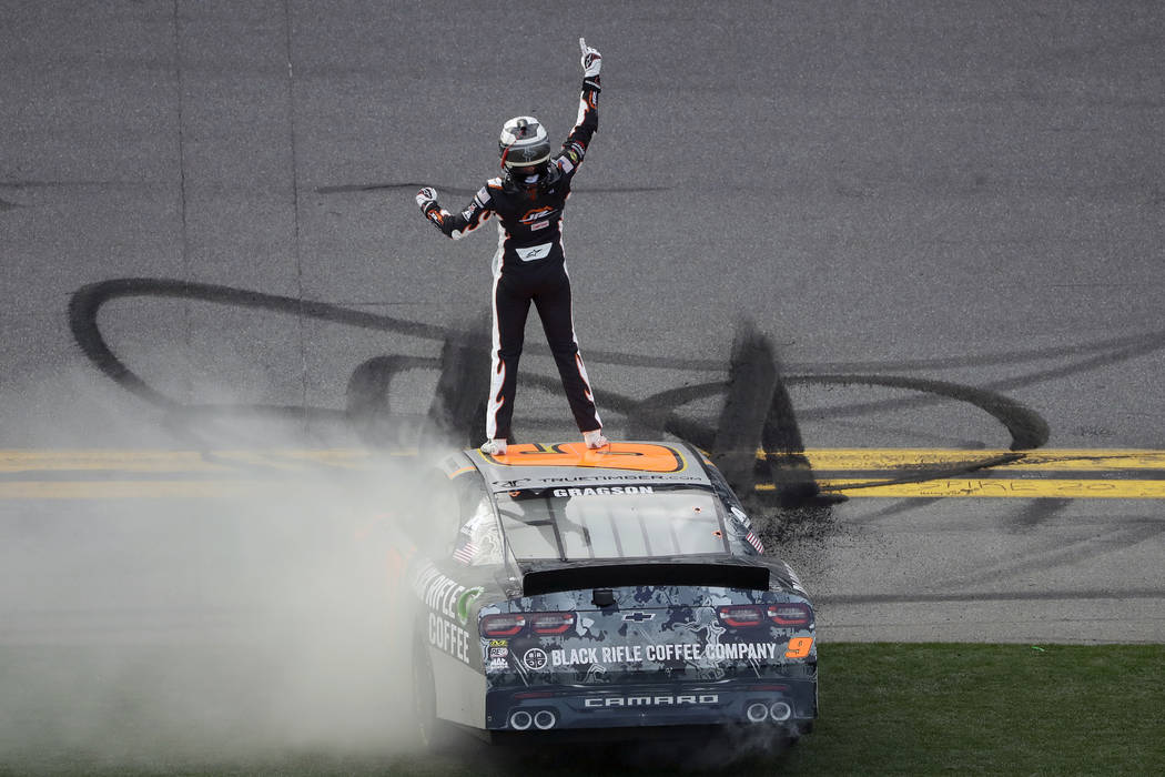 Noah Gragson celebrates on the roof of his car after winning the NASCAR Xfinity series auto rac ...