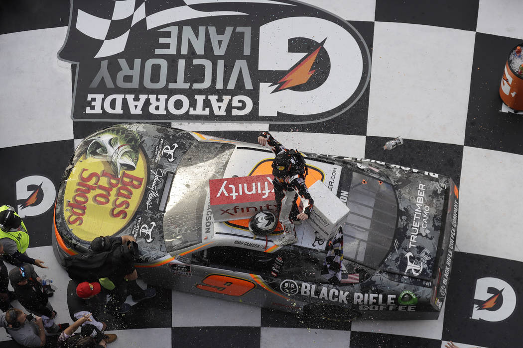 Noah Gragson celebrates on roof of his car in Victory Lane after winning the NASCAR Xfinity ser ...