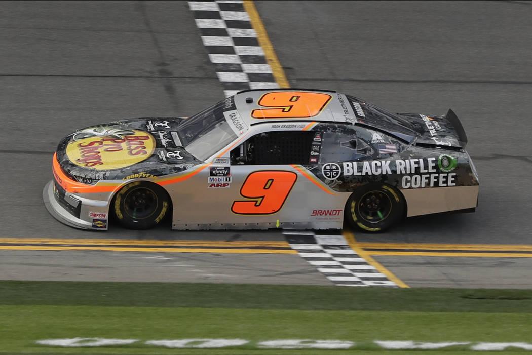 Noah Gragson crosses the finish line to win the NASCAR Xfinity series auto race at Daytona Inte ...