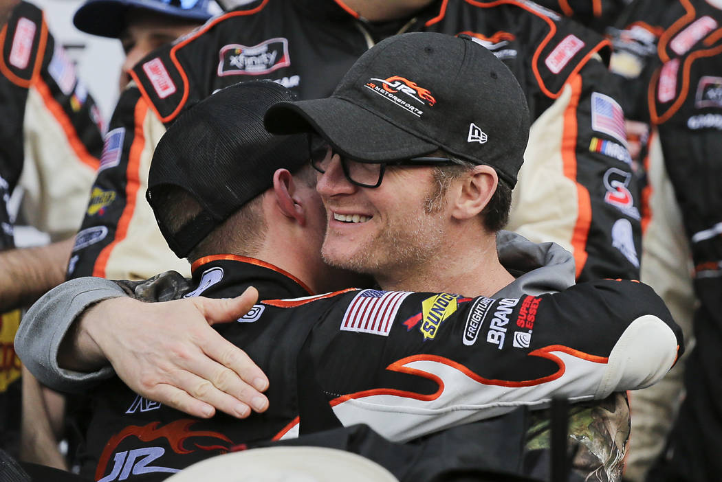 Car owner Dale Earnhardt Jr., right, hugs driver Noah Gragson in Victory Lane after he won the ...