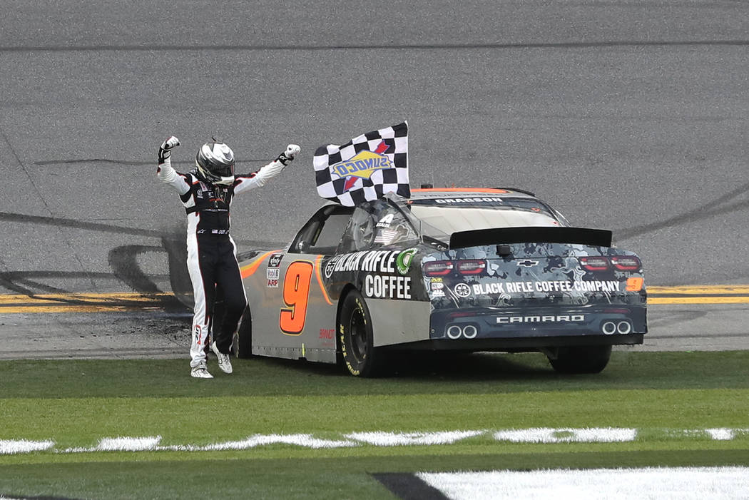 Noah Gragson celebrates in front of fans after winning the NASCAR Xfinity series auto race at D ...