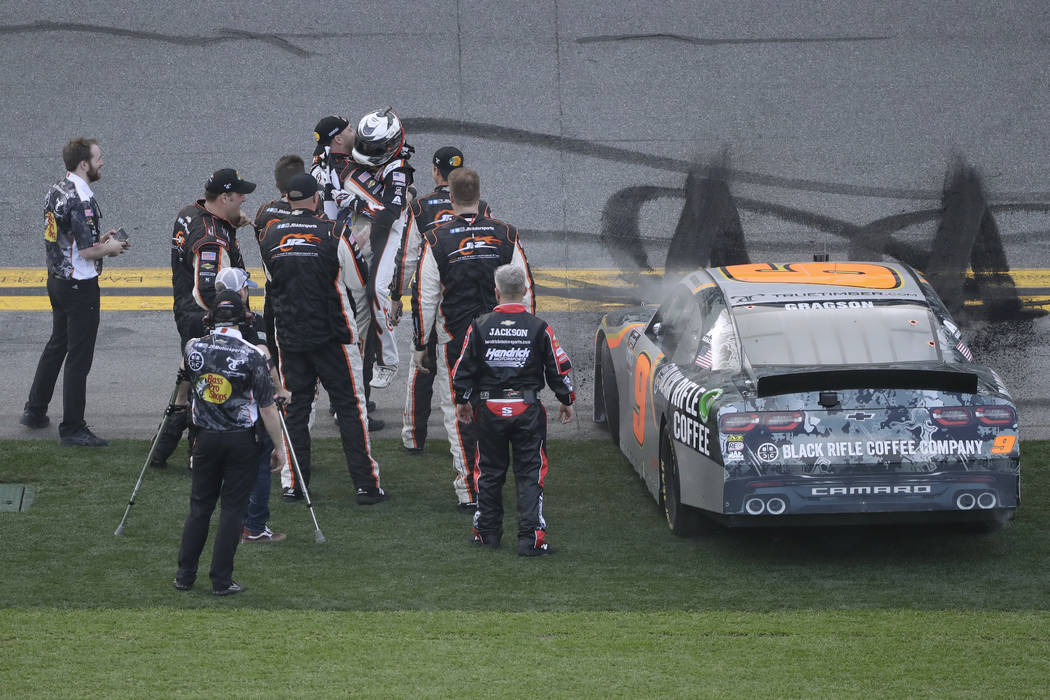 Noah Gragson celebrates with his crew after winning the NASCAR Xfinity series auto race Saturda ...