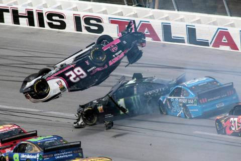 Brendan Gaughan (62) flips in Turn 3 as driver Kurt Busch (1) and David Ragan (38) pass underne ...