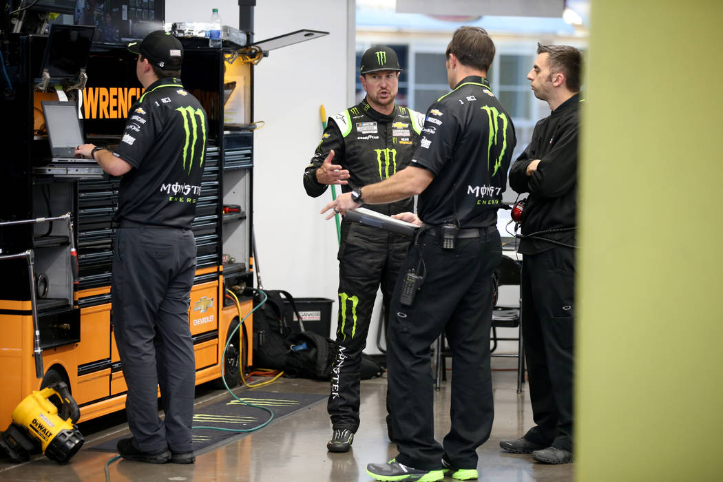 NASCAR Cup Series driver Kurt Busch (1) third from right, talks to his crew after practice for ...