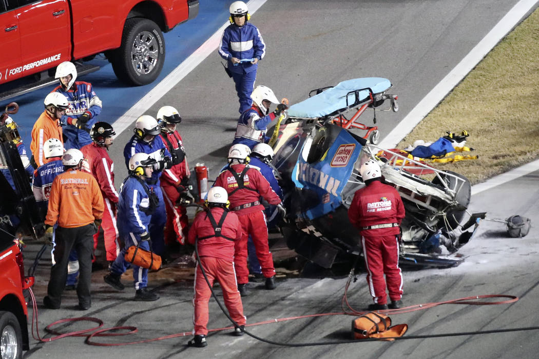 Rescue workers arrive to check on Ryan Newman after he was involved in a wreck on the last lap ...