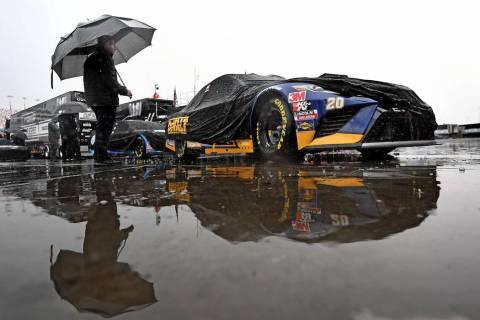 The crew of NASCAR Cup Series driver Erik Jones (20) Joe Gibbs Racing (JGR) Toyota Camry wait i ...