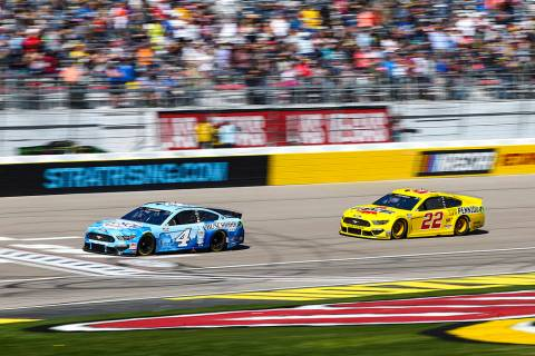 Kevin Harvick (4) and Joey Logano (22) drive during a NASCAR Cup Series auto race at the Las Ve ...