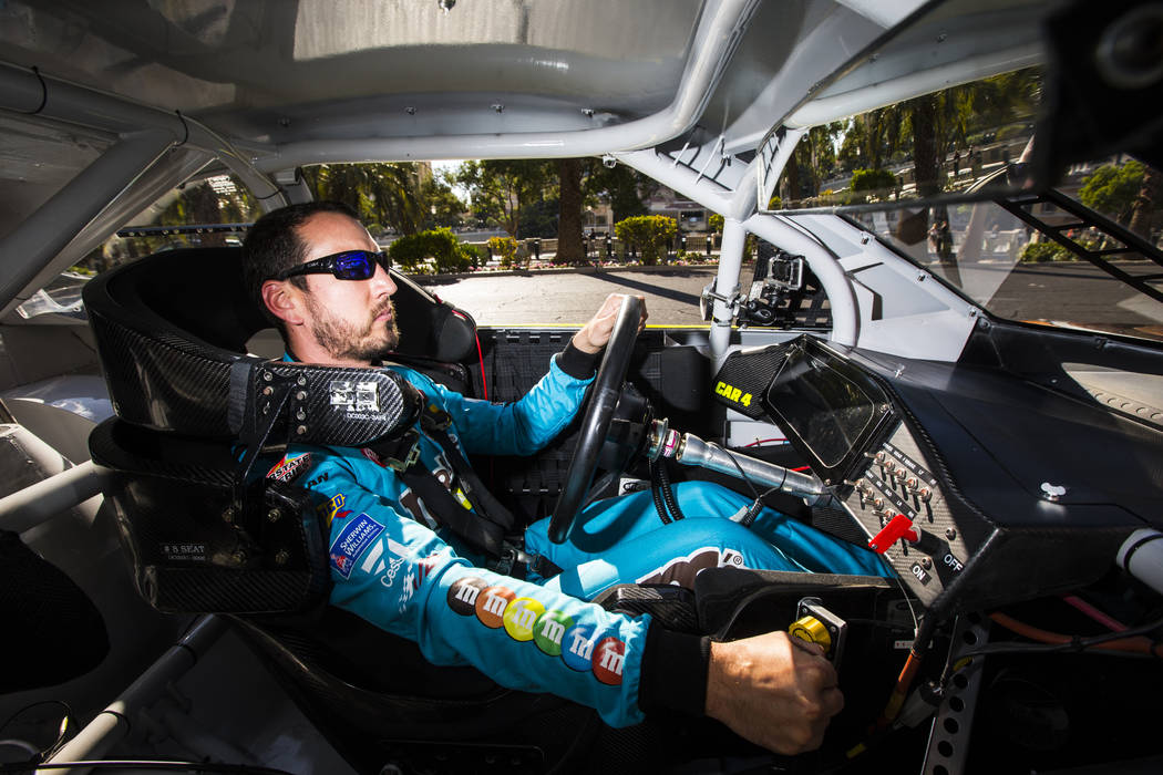 Kyle Busch passes the Bellagio while driving down the Las Vegas Strip before performing a burno ...