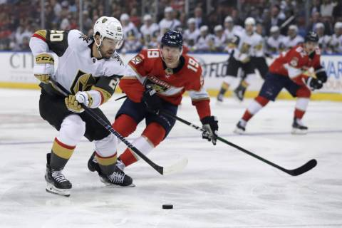 Vegas Golden Knights center Chandler Stephenson (20) skates with the puck as Florida Panthers d ...
